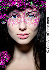 Portrait girl with creative make-up and pink flowers -...
