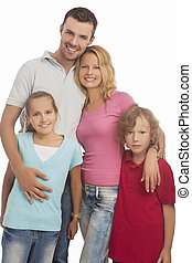portrait of young happy caucasian family standing together...
