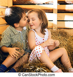 Children on Hayloft - beautiful children on hayloft at sunny...