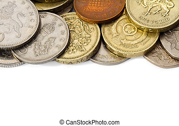 British Coins with White Copy Space - An edge of a pile of...
