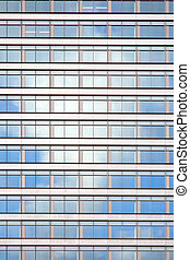 facade of office building reflecting white cloud - facade of...