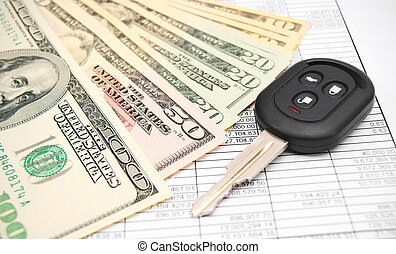 Key from the car and dollars on documents.