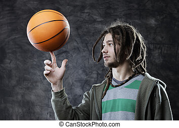 Basketball player - Portrait of young man spinning...
