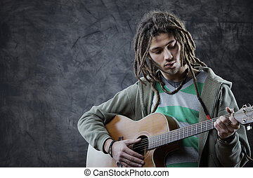 Guitarist - Young man playing acoustic guitar