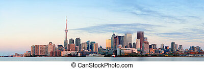 Toronto sunrise with sunlight reflection over lake in the...
