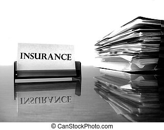 Insurance Card and Files - Insurance card on desk with files