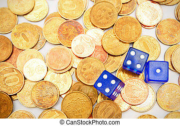 Dices on coins.