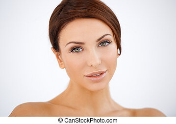 Beautiful serene woman with lovely smooth skin and a gentle...