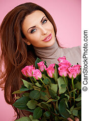 Romantic woman with pink roses - Beautiful smiling romantic...