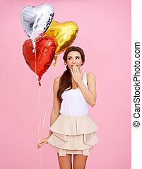 Cute woman with heart shaped party balloons - Cute beautiful...