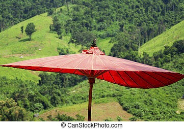 Lanna red umbrella in forest background