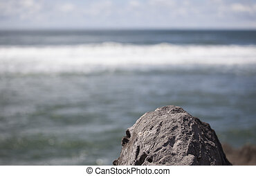 Rock with Abstract Ocean Background - A rock with an...