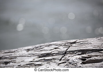 Log with Abstract Ocean Background - A log with an abstract...
