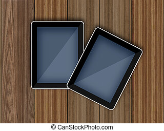 tablet pc computer on wood