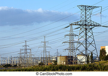 Transmission towers of nuclear powe - Electricity pylons at...