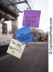 positive sticky notes posted on bus shelter - some positive...