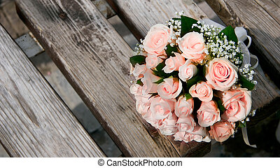 wedding bouquet on wooden bench