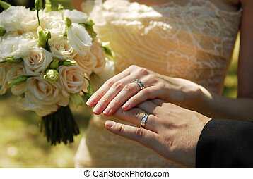 Wedding rings - Newlyweds holding the wedding rings