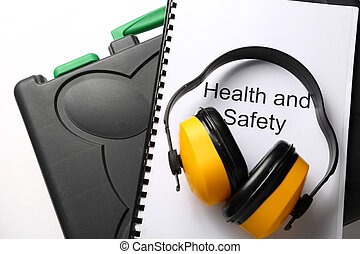 Black toolbox with earphones on white background