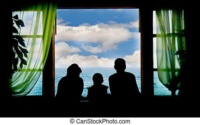 family on vacation, silhouettes on sky background