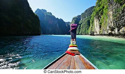 Moving on thai wooden boat