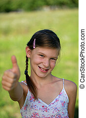 Happy girl giving thumbs up - Happy girl with pigtails...