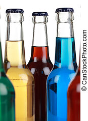 Colorful bottles with soda isolated on a white background