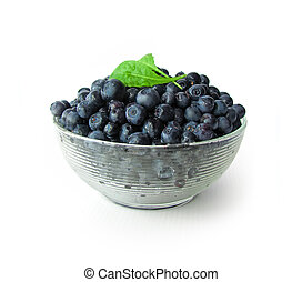 Whortleberries in glass bowl isolated on white background