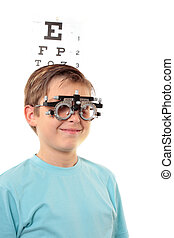 Child vision checkup - A boy with trial frames during a...