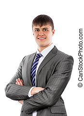 Young businessman poses confidently with crossed arms....
