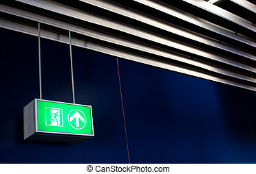 Emergency Exit - Emergency exit sign in modern offices...