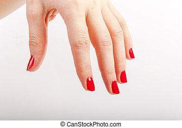 Female hand with red painted nails