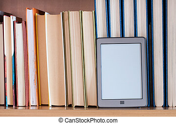 ebook - ereader placed on the books of a library