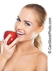 Laughing woman with a red apple - Laughing blonde woman with...