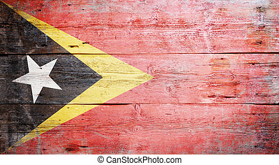 Flag of East Timor painted on grungy wood plank background