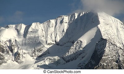 Moutain peak close - Snowcapped mountain top in the alps...