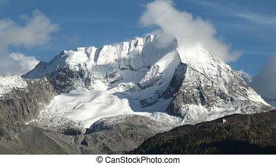 Mountain peak - Snowcapped mountain top in the alps...