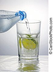Water is healthy - Pouring sparkling water into a caipirinha...