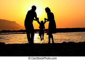 happy family of three silhouette - silhouette of a young...