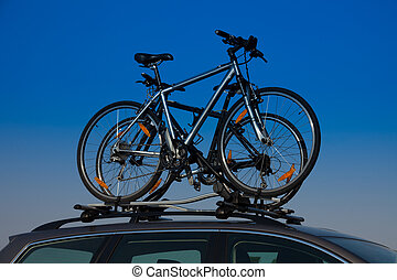 Bike transportation - two bikes on the roof of a car