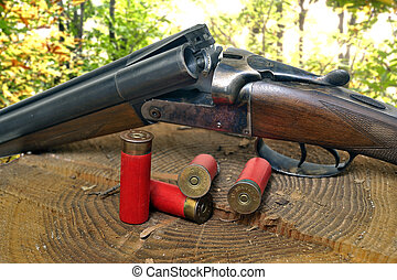 shotgun and its cartridges Still life representing hunting