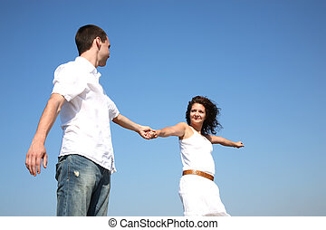 follow me - young happy couple outdoors