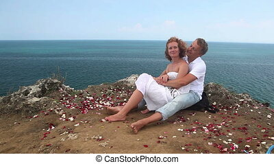 Honeymoon - Attractive happy couple embracing each other and...