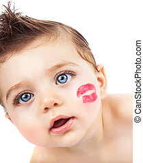 Kid with kiss - Picture of small pretty kid with red...