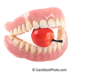 Teeth and apple - Dentures with little fake apple, isolated...
