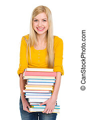Happy student girl holding pile of books