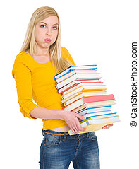 Tired student girl holding pile of books