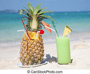 Fresh fruit cocktail on a tropical island beach