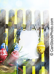 Art easter background with fence, eggs, spring flowers,...