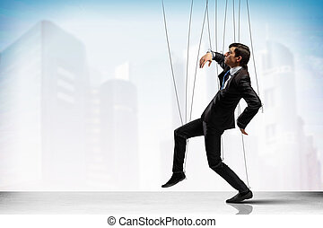 Puppet businessman - Image of businessman hanging on strings...